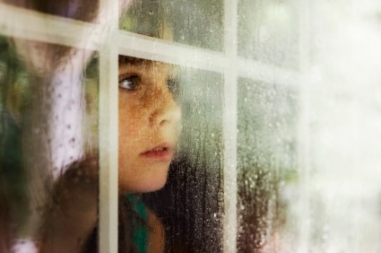 little-girl-looking-out-window
