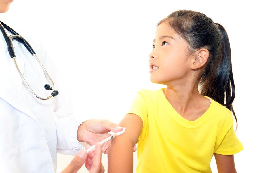 Doctor injecting child vaccine isolated on white background
