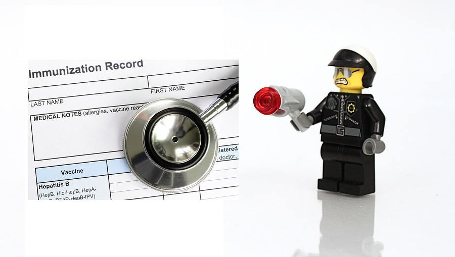 Studio shot of Lego cop with gun.