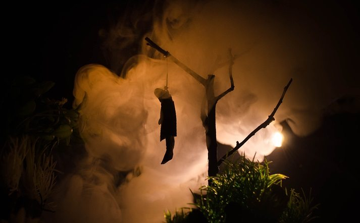 Horror view of hanged girl on tree at evening (at night)
