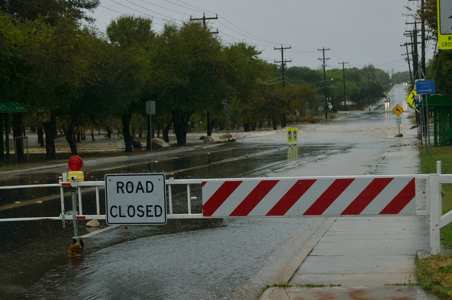 SAN ANTONIO, TX - OCTOBER 24, 2015: Evers Rd. is flooded by a raging Huebner Creek due to excess rain from Hurricane Patricia on October 24, 2015 in San Antonio, Texas.