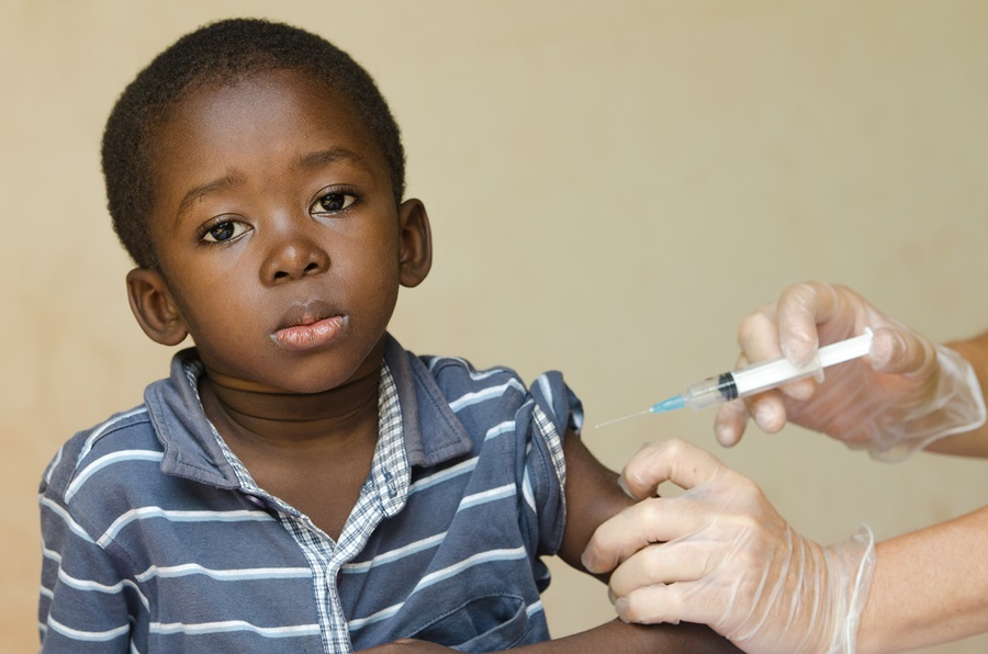 Close-up of a little black African ethnicity boy getting a medical injection as a vaccination.