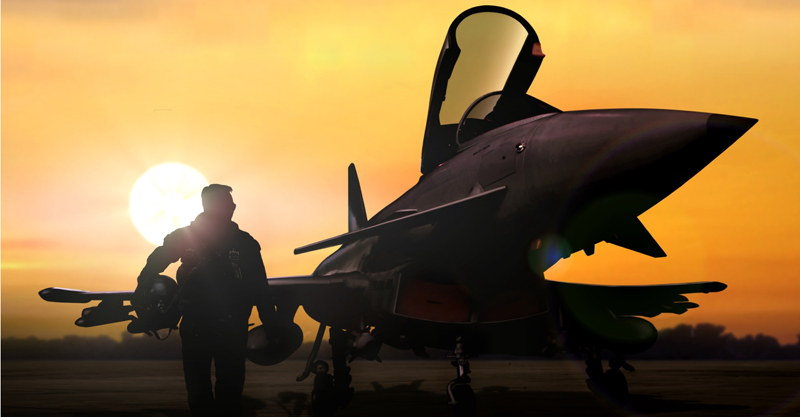 Military pilot and aircraft at airfield on mission standby