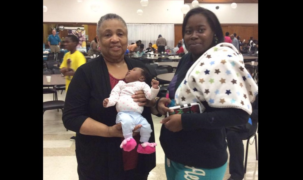 Milwaukee Healthy Beginnings Milwaukee African American Infant Mortality Task Force Patricia McManus holding baby FB