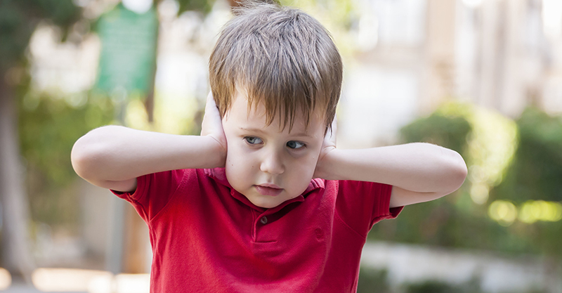 Federal Agencies and Public Health Experts Refuse to Declare Autism a National Health Crisis 04-19-Boy-covering-ears_Featured_Image