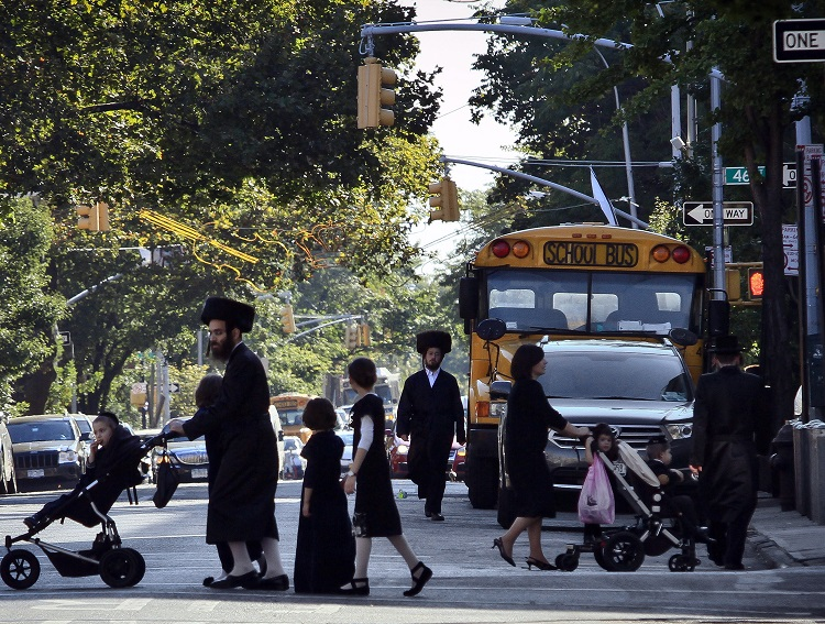 Orthodox Jews in Borough Park, a neighborhood in the Brooklyn borough of New York. (AP Photo/Bebeto Matthews, File)