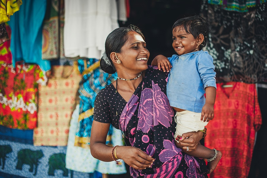 India, Goa, the village of Benaulim  - November 15, 2012: Unidentified Indian woman and baby in her arms are smiling with very good mood. A mother and her child.