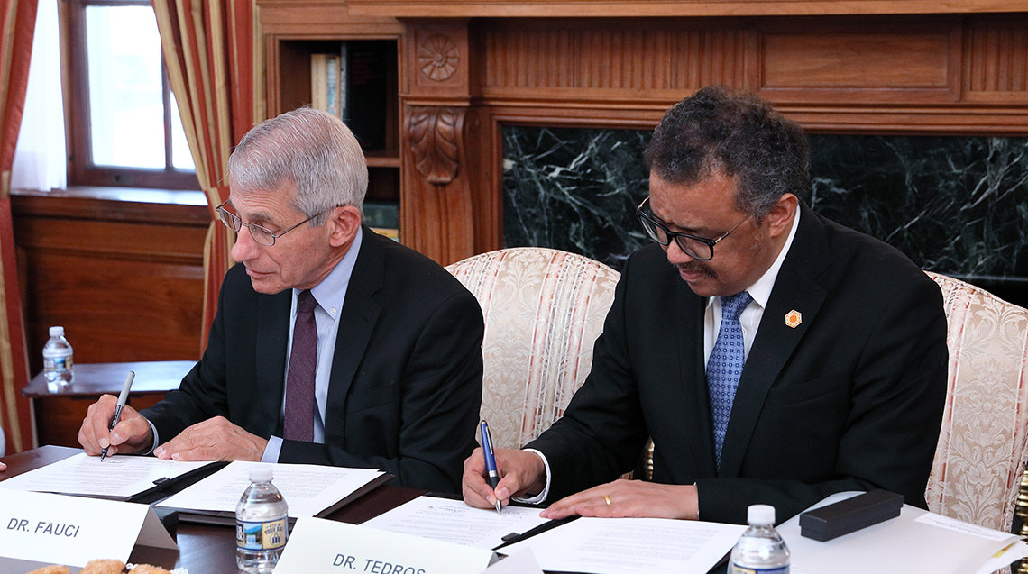 WHO director Tedros with NIAID director Dr. Anthony Fauci in 2018 signing a memorandum of understanding between NIAID and WHO to enhance future collaborations on research activities conducted in response to emerging infectious disease outbreaks and public health emergencie